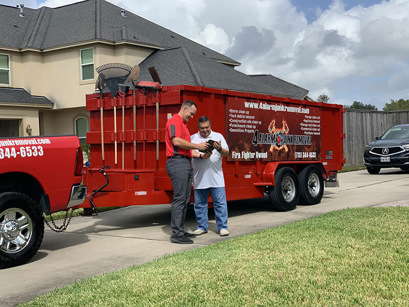 4 Alarm Junk Removal with a happy customer